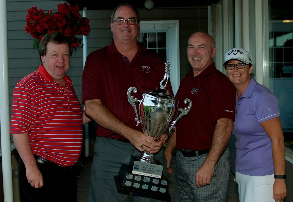 Mayor Clifford Lee (left) and Tracy Smith (right) Present the the 6th annual Bob Bateman Memorial Mayors Cup Golf Tournament trophy to the winning team Holland College!